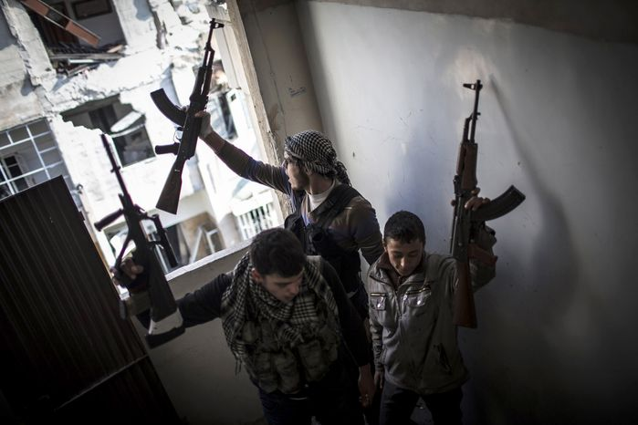 Free Syrian Army members react to fighting in Aleppo, Syria, on Jan. 3, 2013. The area is immersed in a Syrian civil war that the United Nations estimates has killed more than 60,000 people since the revolt against President Bashar Assad began in March 2011. (Associated Press)