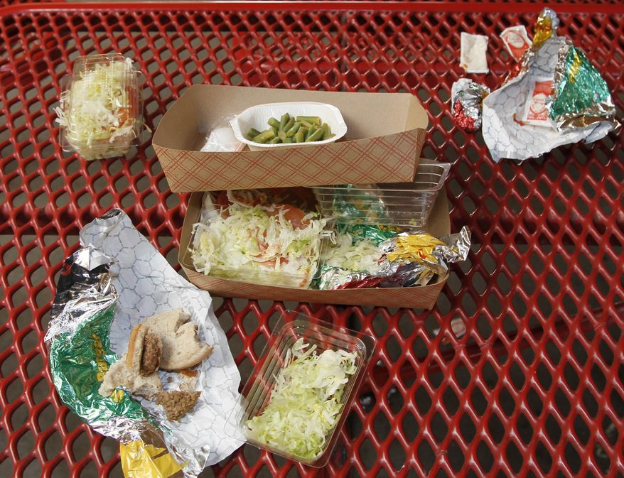 ** FILE ** This Jan. 17, 2012, file photo shows vegetables left over by students on their cafeteria trays at the Roosevelt High School in Los Angeles. (AP Photo/Damian Dovarganes, File)