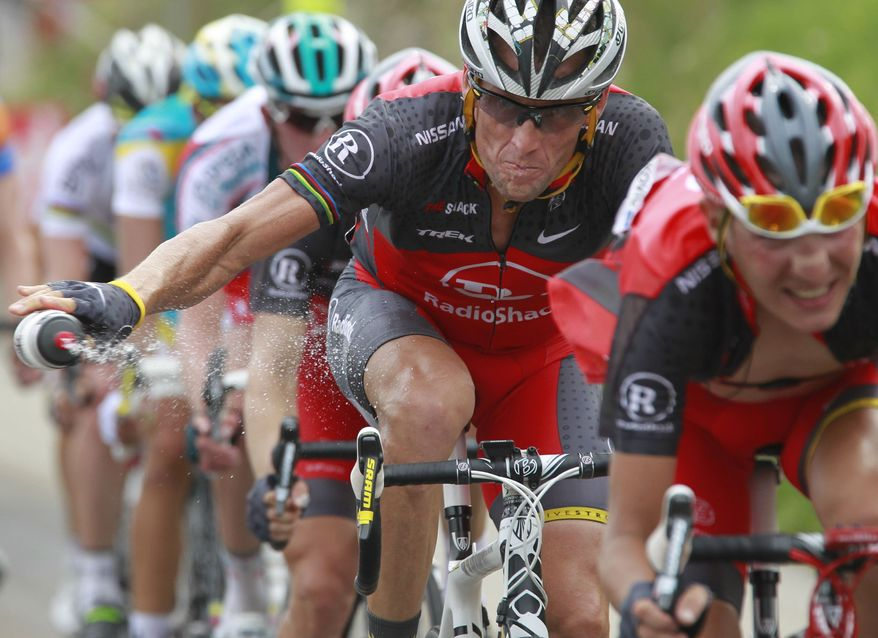 ** FILE ** In this July 10, 2010, file photo, Lance Armstrong throws out his water bottle in the last kilometers of the climb toward Station les Rousses, France, during the seventh stage of the Tour de France cycling race. The New York Times reported Friday, Jan. 4, 2013, that Armstrong, who has strongly denied the doping charges that led to him being stripped of his seven Tour de France titles, has told associates he is considering admitting to the use of performance-enhancing drugs. (AP Photo/Bas Czerwinski, File)