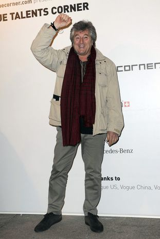 ** FILE ** In this photo taken on Feb. 23, 2010, Vittorio Missoni poses for photographers in Milan, Italy. The search resumed Saturday, Jan. 5, 2013, for a small plane that has disappeared off the Venezuelan coast with six people aboard, including Vittorio Missoni, a top executive in Italy's Missoni fashion house, officials said. (AP Photo/Gian Mattia d'Alberto, Lapresse)