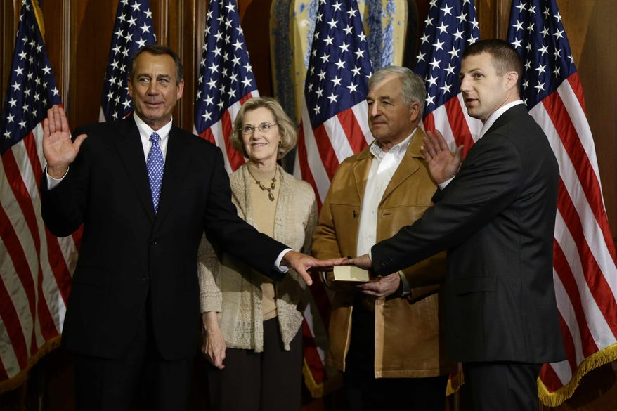 House Speaker John Boehner of Ohio performs a mock swearing in for Rep. Markwayne Mullin, R-Okla., Thursday, Jan. 3, 2013, on Capitol Hill in Washington as the 113th Congress began. (AP Photo/Charles Dharapak)