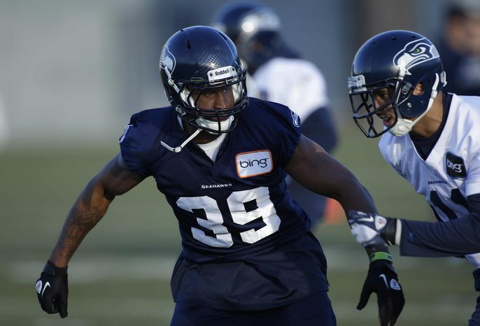 Seattle Seahawks cornerback Brandon Browner (39) squares off against teammate Jermaine Kearse, right, during NFL football practice on Thursday, Jan. 3, 2013, in Renton, Wash. Browner will be back in action with the Seahawks after serving a four-game suspension, as they face the Washington Redskins, Sunday, Jan. 6, 2013, in an NFC wildcard playoff game. (AP Photo/Ted S. Warren)