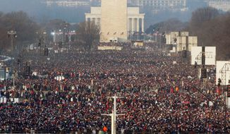 Nearly 2 million people went to the Mall to see Barack Obama take the oath of office in January 2009. D.C. officials expect 600,000 to 800,000 people for a scaled-back event Jan. 21 as Mr. Obama begins his second term. (Associated Press)