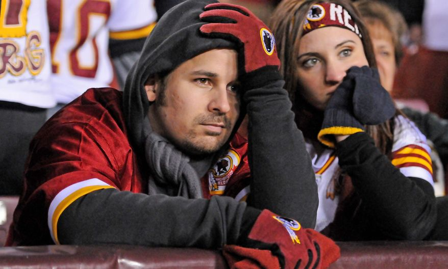 Preston Keres/Special to The Washington Times Redskins fans sit dejectedly after a 24-14 loss in the NFC wild-card game, which had been made possible by a seven-game regular-season win streak.