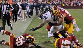 Preston Keres/special to the washington times Seattle running back Marshawn Lynch made his way through the Washington defense to score on a 27-yard touchdown run during the fourth quarter that proved to be the game-winner Sunday at FedEx Field.