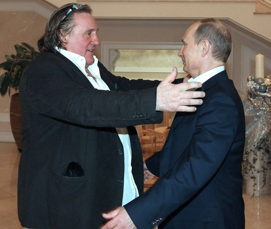 ** FILE ** Russian President Vladimir Putin (right) greets French actor Gerard Depardieu after Mr. Depardieu's arrival late Saturday, Jan. 5, 2013, at the president's residence in Sochi, Russia, the host city of the 2014 Winter Olympics. (AP Photo/RIA-Novosti, Mikhail Klimentyev, Presidential Press Service)