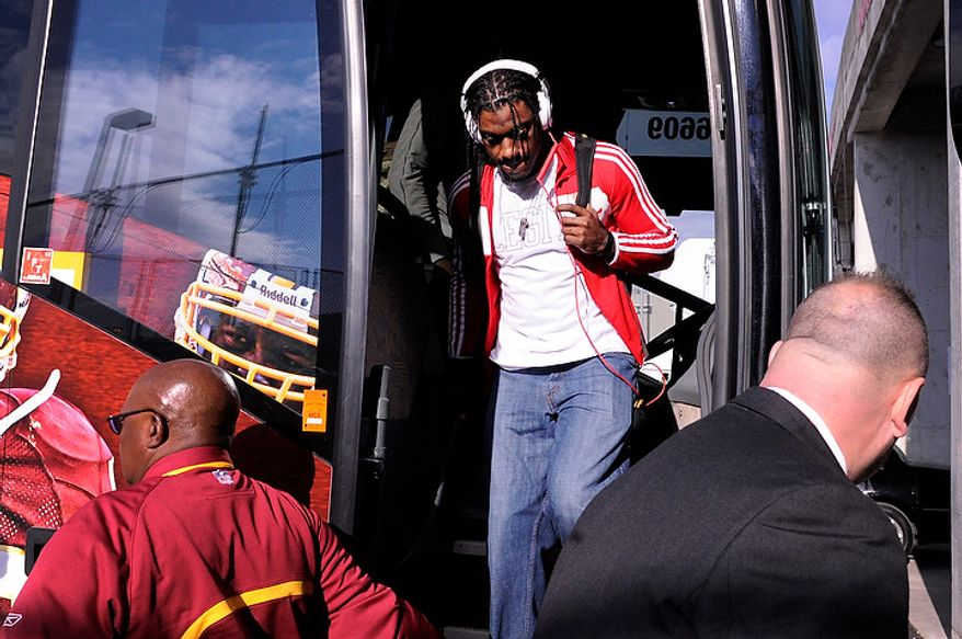 Washington Redskins quarterback Robert Griffin III walks off the bus before the game at FedEx Field, Landover, Md., Jan. 6, 2013. (Preston Keres/Special to The Washington Times)
