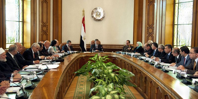 President Mohammed Morsi (center) meets with his Cabinet, including 10 new ministers after their swearing in, at the presidential palace in Cairo on Sunday, Jan. 6, 2013. (AP Photo/Egyptian Presidency)