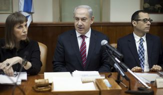 Israeli Prime Minister Benjamin Netanyahu (center) heads the weekly Cabinet meeting in his Jerusalem office on Sunday, Jan. 6, 2013. Mr. Netanyahu said Israel will erect a fortified fence on the border with Syria to protect against radical Islamist forces that he claims have taken over the area. (AP Photo/Uriel Sinai, Pool)