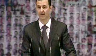 ** FILE ** Syrian President Bashar Assad (Associated Press)