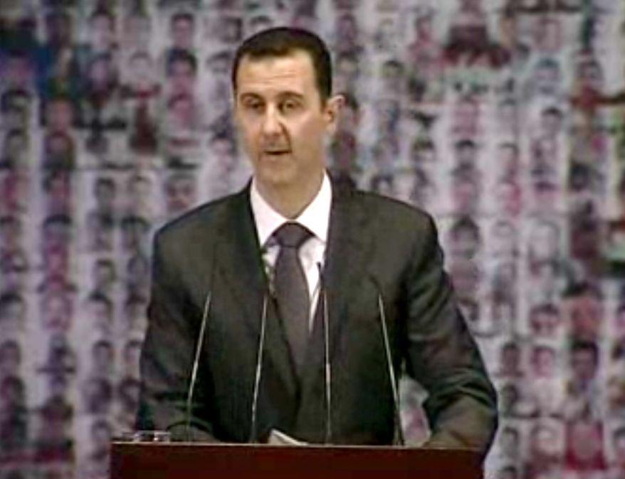 ** FILE ** Syrian President Bashar Assad (Associated Press)