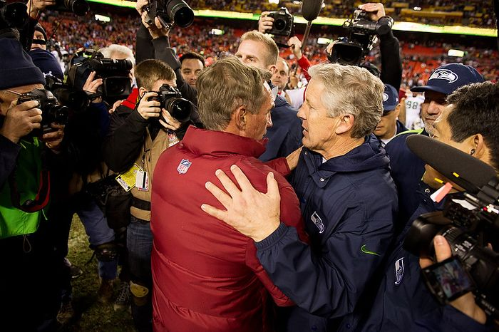 Washington Redskins head coach Mike Shanahan and Seattle Seahawks head coach Pete Carroll shake hands after the game as the Washington Redskins play the Seattle Seahawks during the NFC wild card game at FedEx Field, Landover, Md., Sunday, January 6, 2013. (Andrew Harnik/The Washington Times)