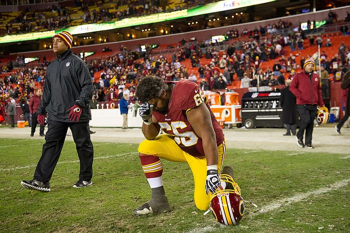 Washington Redskins guard Chris Chester (66) takes a minute to himself after the Washington Redskins lose to the Seattle Seahawks 24-14 in the NFC wild card game at FedEx Field, Landover, Md., Sunday, January 6, 2013. (Andrew Harnik/The Washington Times)
