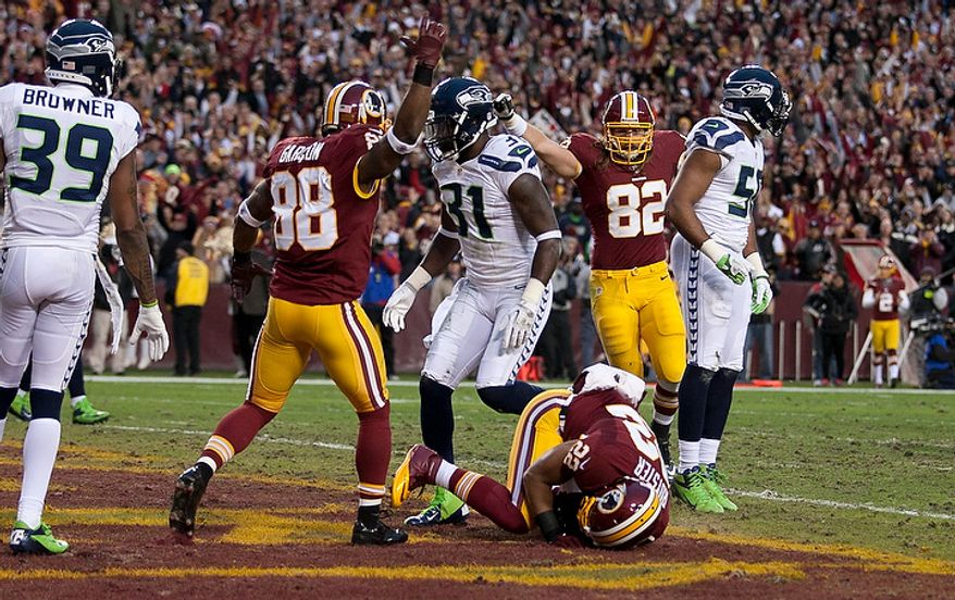 Washington Redskins running back Evan Royster (22) halls in the Washington Redskins first touchdown in the first quarter on a pass by Washington Redskins quarterback Robert Griffin III (10) in the NFC wild card game against the Seattle Seahawks at FedEx Field, Landover, Md., Sunday, January 6, 2013. (Craig Bisacre/The Washington Times)