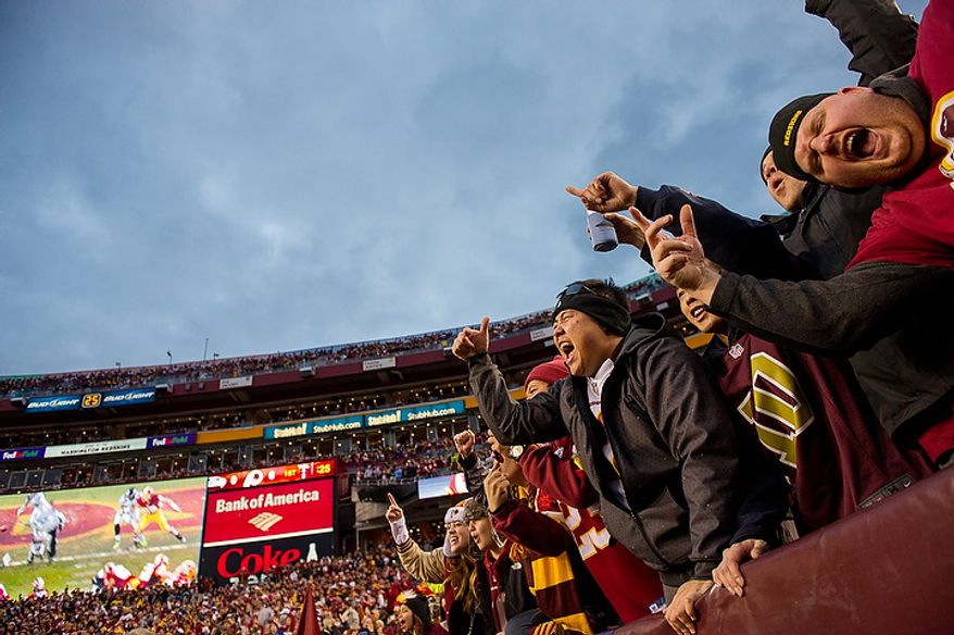 Fans cheer after Washington Redskins running back Evan Royster (22) scores on a 4 yard pass in the first quarter as the Washington Redskins play the Seattle Seahawks during the NFC wild card game at FedEx Field, Landover, Md., Sunday, January 6, 2013. (Andrew Harnik/The Washington Times)