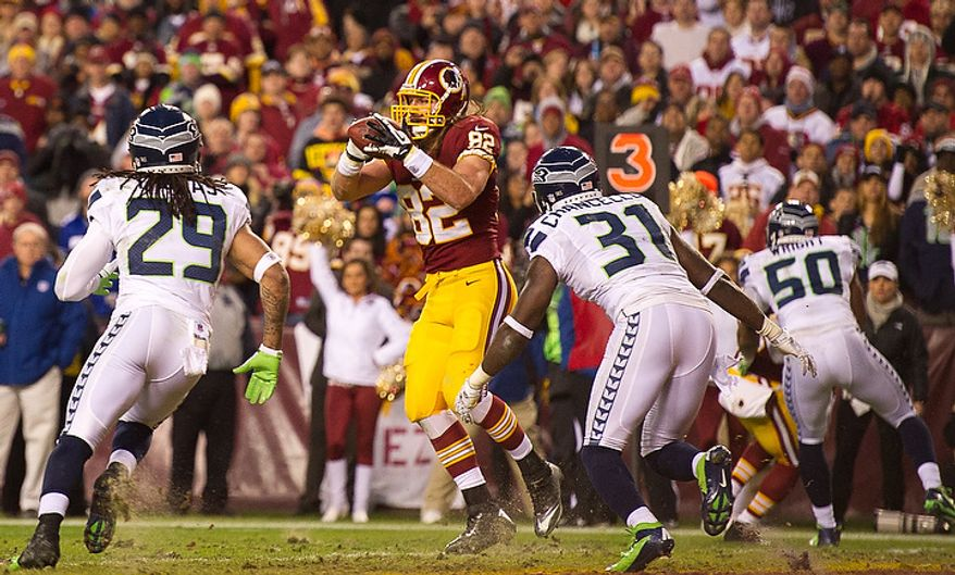 Washington Redskins tight end Logan Paulsen (82) catches a 4 yard touchdown pass in the first quarter as the Washington Redskins play the Seattle Seahawks during the NFC wild card game at FedEx Field, Landover, Md., Sunday, January 6, 2013. (Andrew Harnik/The Washington Times)