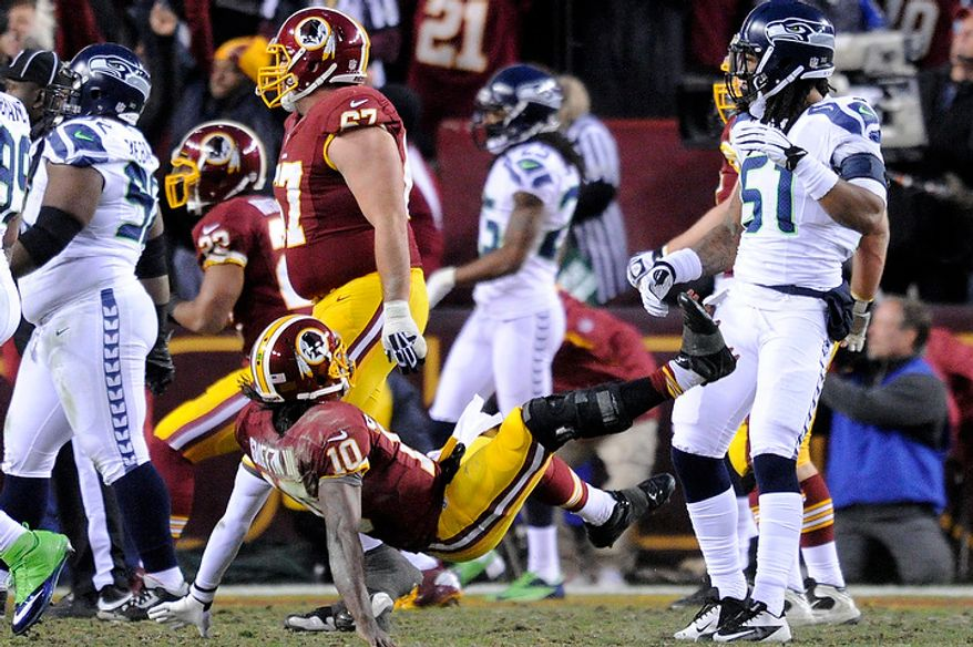 Washington Redskins quarterback Robert Griffin III (10) is knocked to the ground by Seattle Seahawks defensive end Bruce Irvin (51), who is called for unnecessary roughness after a first quarter touchdown in the NFC wild card game at FedEx Field, Landover, Md., Jan. 6, 2013. (Preston Keres/Special to The Washington Times)
