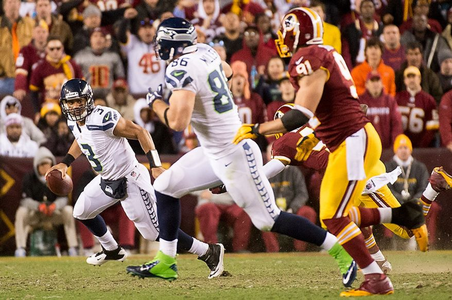 Seattle Seahawks quarterback Russell Wilson (3) scrables for a 4 yard gain in the second quarter as the Washington Redskins play the Seattle Seahawks during the NFC wild card game at FedEx Field, Landover, Md., Sunday, January 6, 2013. (Andrew Harnik/The Washington Times)