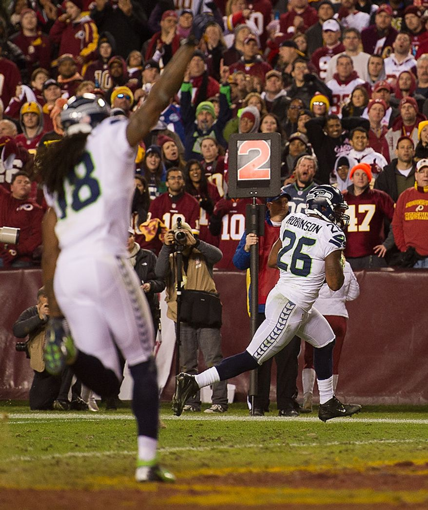 Seattle Seahawks fullback Michael Robinson (26) scores on a 4 yard pass in the second quarter as the Washington Redskins play the Seattle Seahawks during the NFC wild card game at FedEx Field, Landover, Md., Sunday, January 6, 2013. (Andrew Harnik/The Washington Times)