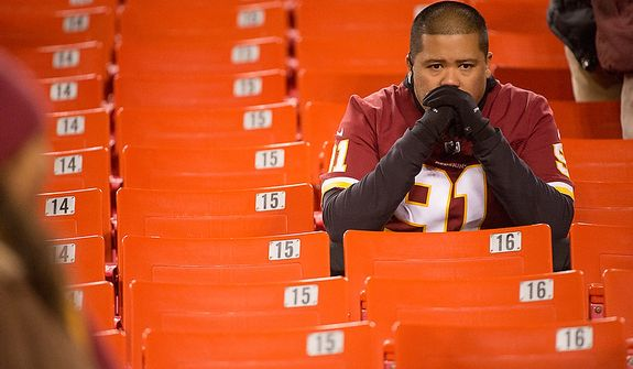A Washington Redskins fan sits in his seat after the Washington Redskins lose to the Seattle Seahawks 24-14 in the NFC wild card game at FedEx Field, Landover, Md., Sunday, January 6, 2013. (Andrew Harnik/The Washington Times)