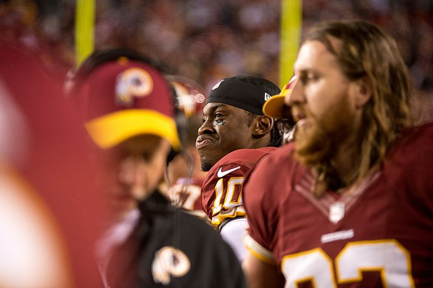 Washington Redskins quarterback Robert Griffin III (10) watches the game from the sideline after leaving the game with an injured knee late in the fourth quarter as the Washington Redskins play the Seattle Seahawks during the NFC wild card game at FedEx Field, Landover, Md., Sunday, January 6, 2013. (Andrew Harnik/The Washington Times)