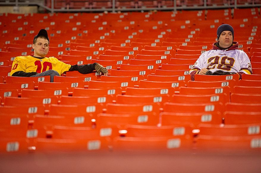 Washington Redskins fans sits in his seat after the Washington Redskins lose to the Seattle Seahawks 24-14 in the NFC wild card game at FedEx Field, Landover, Md., Sunday, January 6, 2013. (Andrew Harnik/The Washington Times)