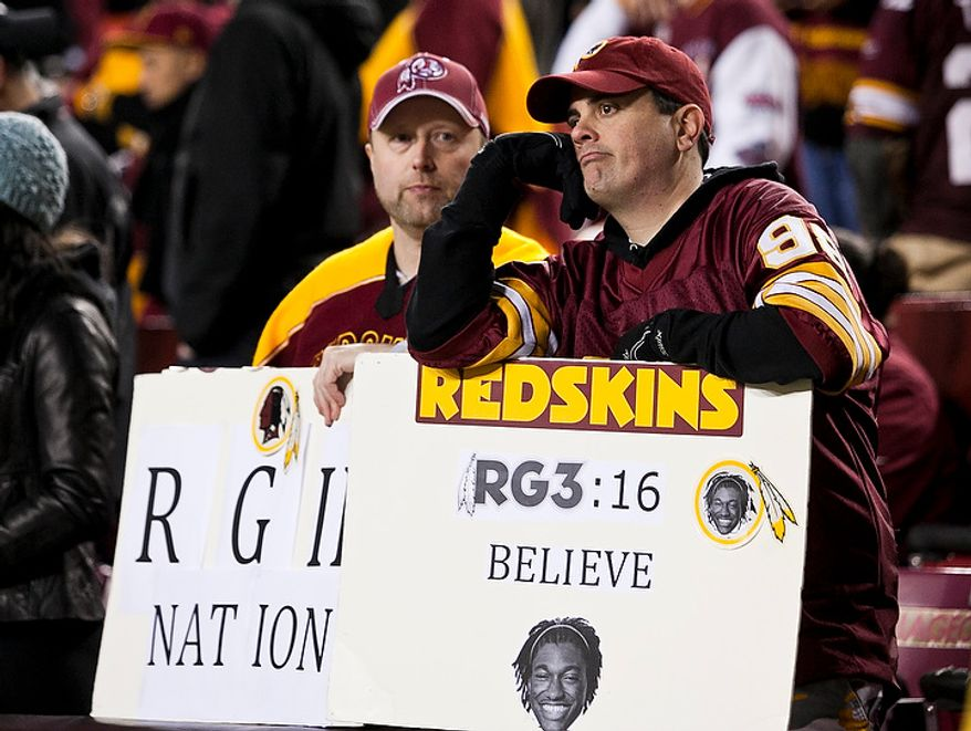 Washington Redskins fans react to a 24 to 14 lose to the Seattle Seahawks in the NFC wild card game at FedEx Field, Landover, Md., Sunday, January 6, 2013. (Craig Bisacre/The Washington Times)