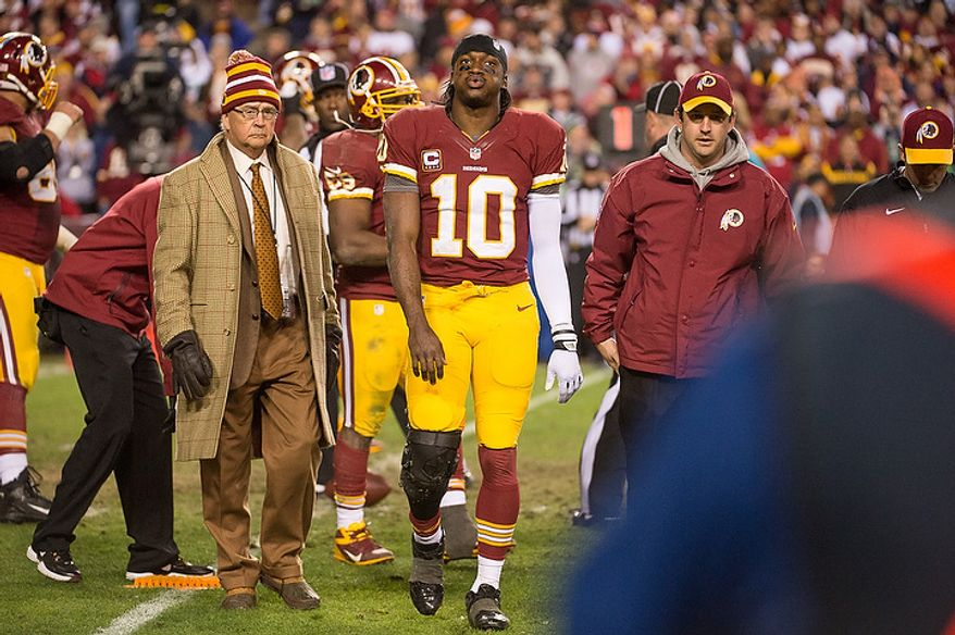 Washington Redskins quarterback Robert Griffin III (10) sighs as he comes out of the game after injuring his knee on a bad snap which was recovered by the Seattle Seahawks late in the fourth quarter as the Washington Redskins play the Seattle Seahawks during the NFC wild card game at FedEx Field, Landover, Md., Sunday, January 6, 2013. (Andrew Harnik/The Washington Times)