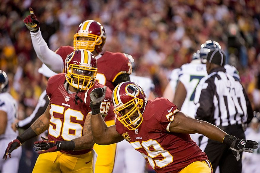 Washington Redskins inside linebacker London Fletcher (59), right, celebrates his sack on Seattle Seahawks quarterback Russell Wilson (3) in the first quarter as the Washington Redskins play the Seattle Seahawks during the NFC wild card game at FedEx Field, Landover, Md., Sunday, January 6, 2013. (Andrew Harnik/The Washington Times)