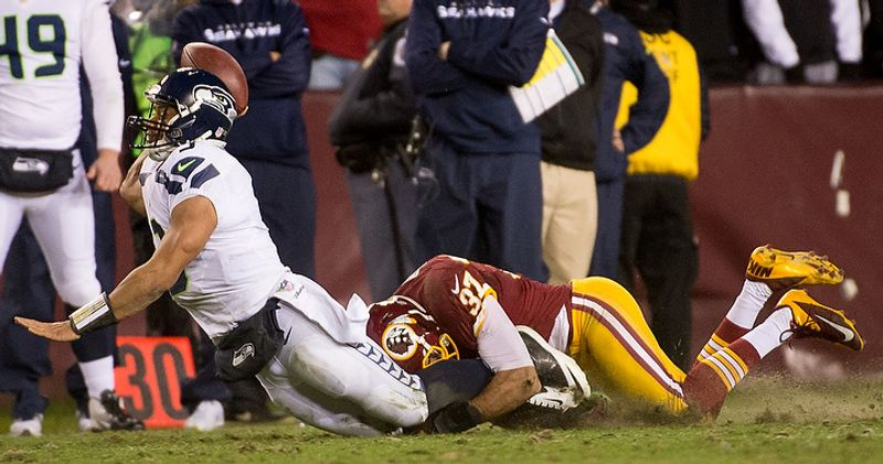 Washington Redskins strong safety Reed Doughty (37) sacks Seattle Seahawks quarterback Russell Wilson (3) for a 5 yard loss in the fourth quarter as the Washington Redskins play the Seattle Seahawks during the NFC wild card game at FedEx Field, Landover, Md., Sunday, January 6, 2013. (Andrew Harnik/The Washington Times)