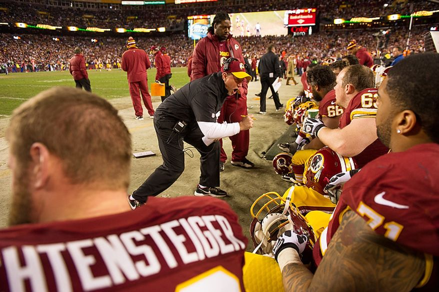 A line coach tries to keep players charged up in the fourth quarter as the Washington Redskins play the Seattle Seahawks during the NFC wild card game at FedEx Field, Landover, Md., Sunday, January 6, 2013. (Andrew Harnik/The Washington Times)