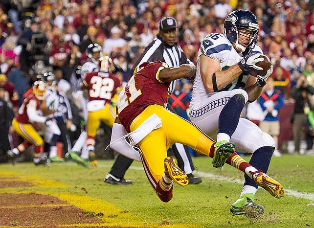 Washington Redskins free safety Madieu Williams (41) can't stop Seattle Seahawks tight end Zach Miller (86) from scoring on a two point conversion as the Washington Redskins play the Seattle Seahawks during the NFC wild card game at FedEx Field, Landover, Md., Sunday, January 6, 2013. (Andrew Harnik/The Washington Times)