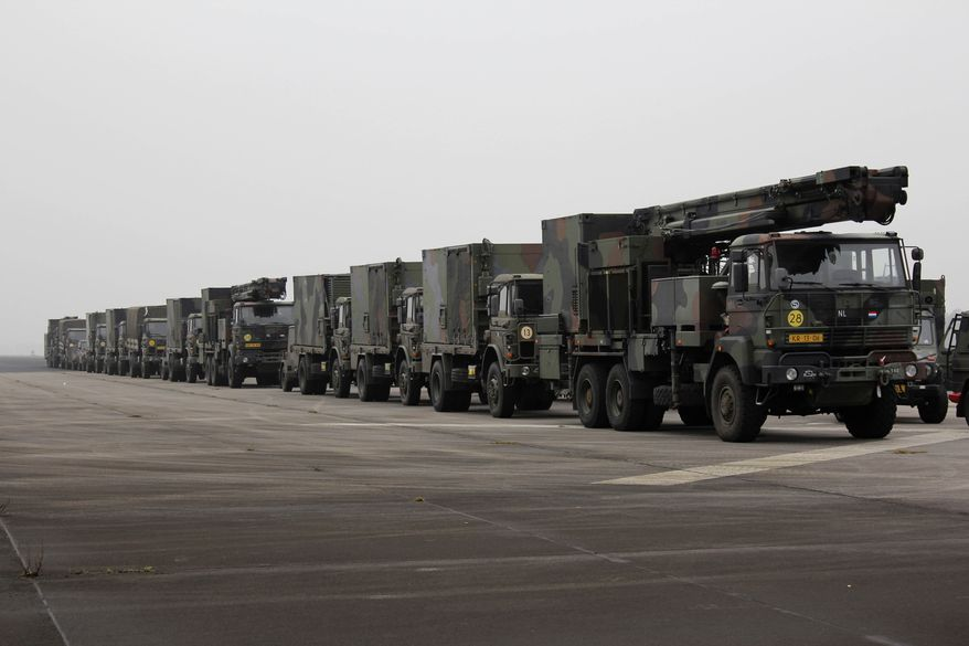 A camouflage convoy of Dutch military trucks carrying two batteries of Patriot missiles is lined up for a media opportunity before departing from De Peel Air Base in Vreedepeel, Netherlands, on Monday, Jan. 7, 2013. Twelve Patriot missile launching systems from the Dutch military are on their way to help Turkey defend its border against Syrian rockets. The missile batteries are scheduled to be fully operational by Jan. 26. (AP Photo/Mark D. Carlson)