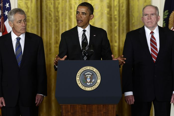 President Obama (center) announces in the East Room of the White House in Washington on Monday, Jan. 7, 2013, that he is nominating John Brennan (right), his deputy national security adviser for homeland security and counterterrorism, as the new director of the CIA, and former Nebraska Sen. Chuck Hagel (left) as the new defense secretary. (AP Photo/Charles Dharapak)