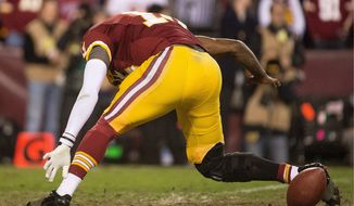 Washington's Robert Griffin III was knocked out of Sunday's playoff loss after his right leg got stuck in the turf when he tried to handle a bad snap. An MRI on his injured knee Monday was inconclusive, so the quarterback is scheduled to meet with Dr. James Andrews on Tuesday to help clarify his status. (Andrew Harnik/The Washington Times)