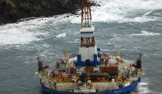 ** FILE ** The conical drilling ship Kulluk sits grounded 40 miles southwest of Kodiak, Alaska, on Thursday, Jan. 3, 2012. (AP Photo/U.S. Coast Guard, Petty Officer 2nd Class Zachary Painter)