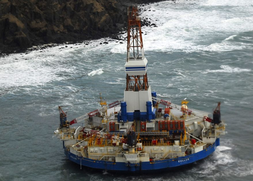 ** FILE ** The conical drilling ship Kulluk sits grounded 40 miles southwest of Kodiak, Alaska, on Thursday, Jan. 3, 2012. (AP Photo/U.S. Coast Guard, Petty Officer 2nd Class Zachary Painter)