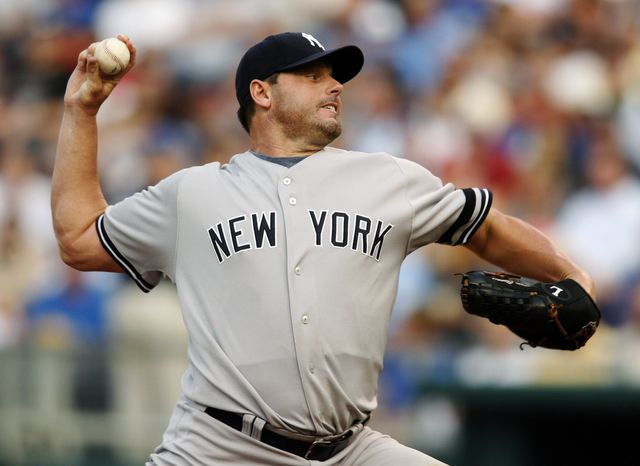 ** FILE ** In this July 23, 2007, file photo, New York Yankees starting pitcher Roger Clemens throws against Kansas City Royals' David DeJesus in the first inning of a baseball game in Kansas City, Mo. With the cloud of steroids shrouding the candidacies of Barry Bonds, Sammy Sosa and Clemens, baseball writers on Wednesday, Jan. 9 ,2013, might not elect anyone to the Hall of Fame for only the second time in four decades. (AP Photo/Ed Zurga, File)