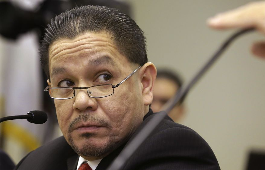 Illinois state Rep. Edward J. Acevedo, Chicago Democrat, listens to lawmakers while testifying during a House committee hearing at the Illinois Capitol on Monday, Jan. 7, 2013, in Springfield Ill. The House on Tuesday passed legislation to allow illegal immigrants to get driver's licenses. (AP Photo/Seth Perlman)