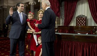 ** FILE ** Vice President Joseph R. Biden (right) administers the Senate oath to Sen. Ted Cruz, Texas Republican, accompanied by his wife, Heidi Nelson, and daughters Caroline and Catherine (second from right) during a mock swearing-in ceremony on Capitol Hill in Washington on Thursday, Jan. 3, 2013, as the 113th Congress officially began. (AP Photo/Evan Vucci)
