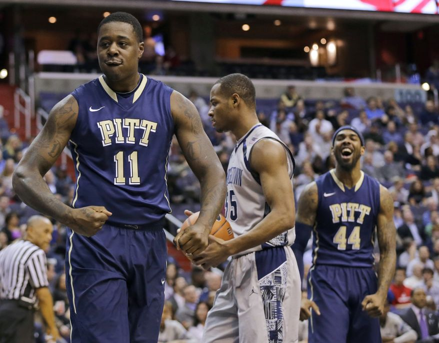 Pittsburgh forward Dante Taylor (11) celebrates his shot as forward J.J. Moore (44) smiles and Georgetown guard Jabril Trawick (55) holds the ball during the first half of an NCAA college basketball game on Tuesday, Jan. 8, 2013, in Washington. (AP Photo/Alex Brandon)