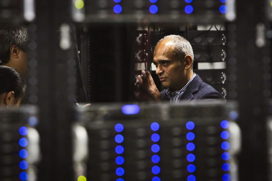 **FILE** Chet Kanojia, founder and CEO of Aereo, Inc., gives a tour of the company's technology floor in New York on Dec. 20, 2012. Aereo is one of several startups created to deliver traditional media over the Internet without licensing agreements. Past efforts have typically been rejected by courts as copyright violations. In Aereo's case, the judge accepted the company's legal reasoning, but with reluctance. (Associated Press)