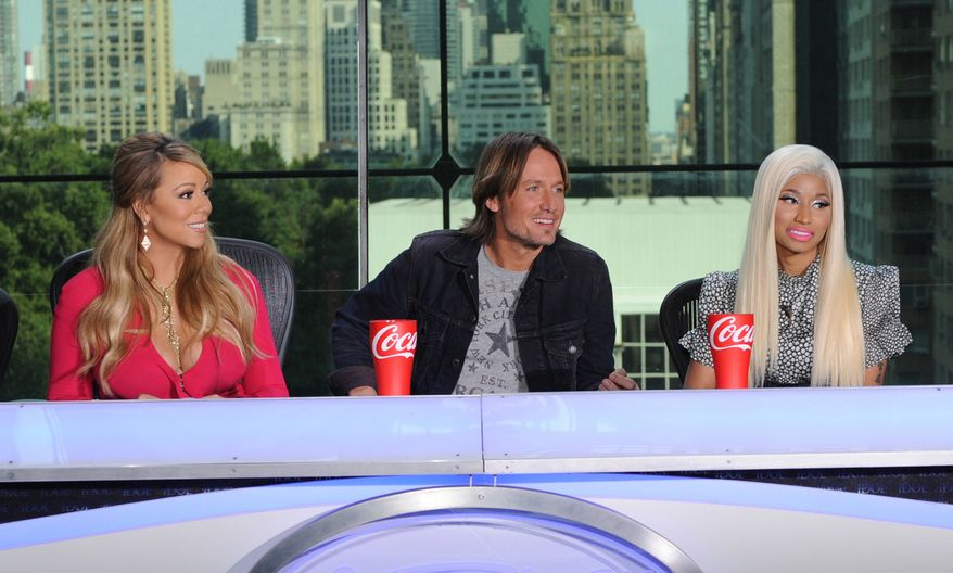 """**FILE** This image released by Fox shows the new judges for the singing competition series, """"American Idol"""" (from left) Mariah Carey, Keith Urban and Nicki Minaj and during a news conference in New York on Sept. 17, 2012. (Associated Press/Fox)"""