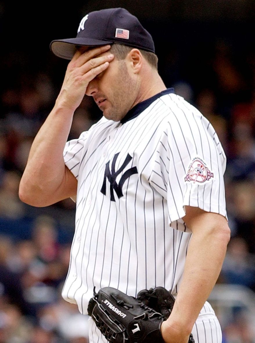 **FILE** New York Yankees starter Roger Clemens reacting on the mound during the third inning of a baseball game against the Boston Red Sox in New York on May 26, 2003. (Associated Press)