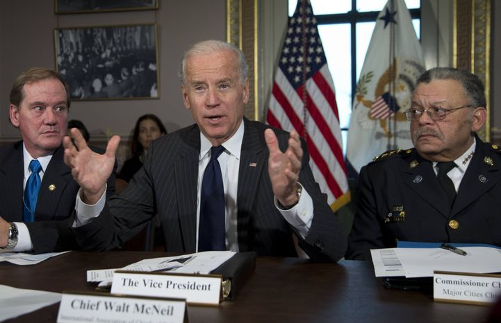 ** FILE ** Vice President Joe Biden, flanked by the president of the National Association of Police Organizations and Boston police officer, Thomas Nee, left, and president of the Police Executive Research Forum and Major Cities Chiefs Association and Philadelphia Police Commissioner Charles Ramsey, right, speaks during a meeting at the Eisenhower Executive Office Building in the White House complex, Thursday, Dec. 20, 2012, in Washington. Biden is leading a task force that will look at ways of reducing gun violence. (AP Photo/Carolyn Kaster)