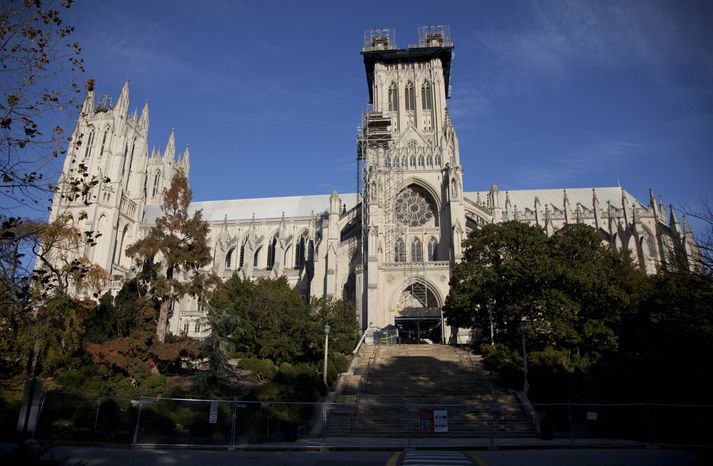 ** FILE ** Scaffolding is seen on the Washington National Cathedral in this Nov. 12, 2011, file photo taken before the consecration service of the first female Bishop of Washington, Rev. Mariann Edgar Budde. The Washington National Cathedral, where the nation gathers to mourn tragedies and celebrate new presidents, will soon begin performing same-sex marriages. It will announce its new policy Wednesday, Jan. 9, 2013. (AP Photo/Carolyn Kaster, File)