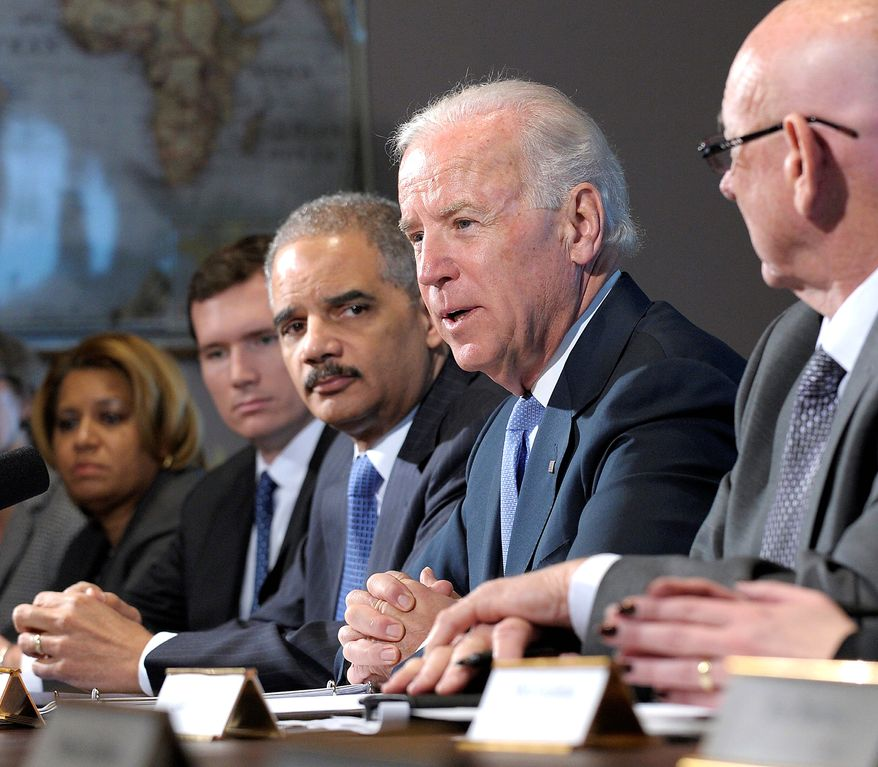 **FILE** Vice President Joseph R. Biden, joined at the White House by Attorney General Eric H. Holder Jr. (left), holds a meeting Jan. 9, 2013, with gun-safety advocates and victims' families. (Associated Press)