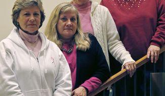The Melnick sisters, who in a suit against Eli Lilly and Co. alleged that a synthetic estrogen known as DES caused them all to get breast cancer, pose at their hotel in Boston on Monday, Jan. 7, 2013. From left are Michele Fecho, Francine Melnick, Donna McNeely and Andrea Andrews. (AP Photo/Charles Krupa)