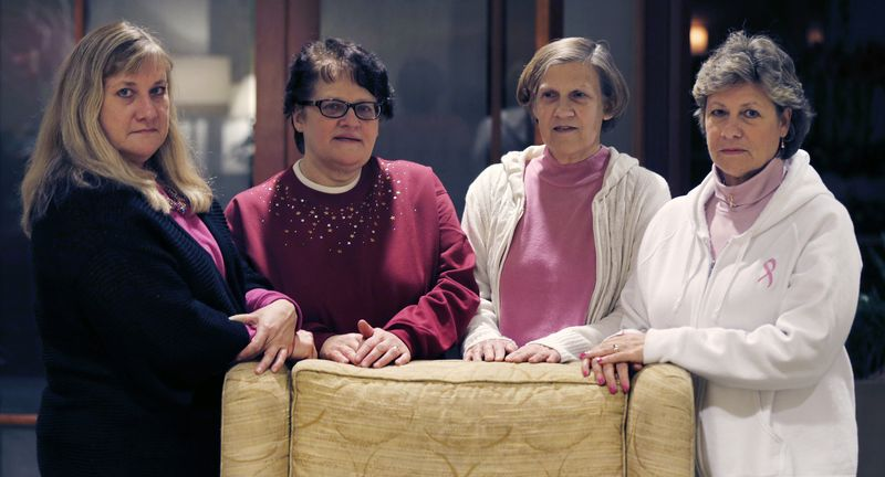The Melnick sisters, who in a suit against Eli Lilly and Co. alleged that a synthetic estrogen known as DES caused them all to get breast cancer, pose at their hotel in Boston on Monday, Jan. 7, 2013. From left are Francine Melnick, Andrea Andrews, Donna McNeely and Michele Fecho. (AP Photo/Charles Krupa)