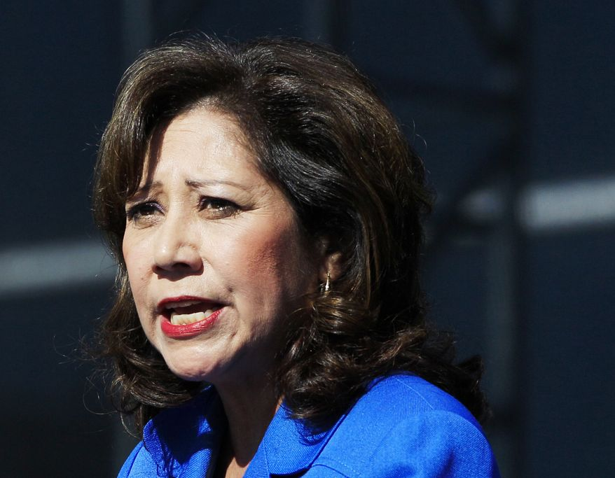 **FILE** Labor Secretary Hilda Solis addresses employees outside the Flat Rock Assembly in Flat Rock, Mich., on Sept. 10, 2012. (Associated Press)